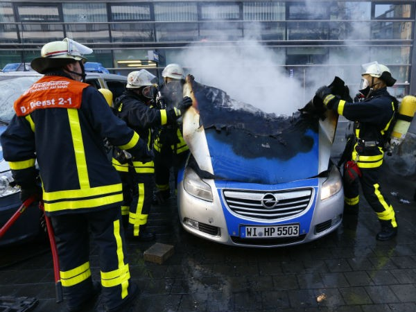 Fireworkers extinguish police vehicles