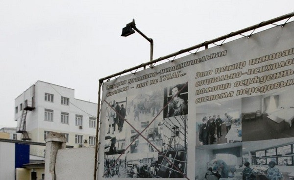 An information board is on display on the fence of a tuberculosis hospital in Russia's Siberian city of Krasnoyarsk