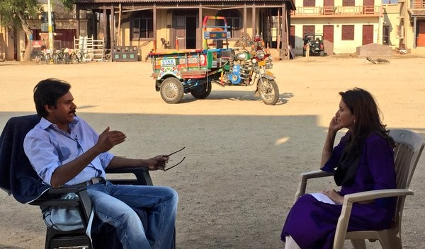Pawan Kalyan talking to Anupama Chopra on the set of Sardaar Gabbar Singh in Hyderabad