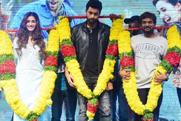 Disha Patani with Varun Tej and Puri Jagannath at the platinum disc launch of Loafer in Vijayawada