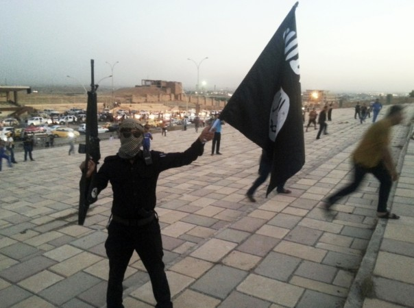isis militant waves flag