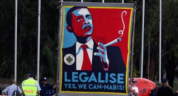 A banner showing Obama smoking cannabis. However, hopes that Obama would be a more tolerant drug warrior have gone up in smoke. | Reuters