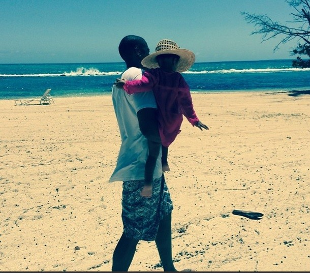 Taking a stroll with daddy Jay Z at the beach