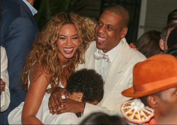 Blu Ivy trying hide in her daddy's lap