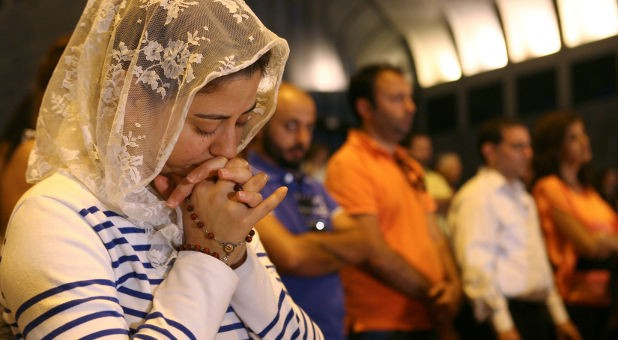 Lebanese and Syrian Christian Maronites pray for peace in Syria, in Harisa, Jounieh