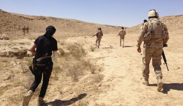 Iraqi security forces are pictured during a patrol looking for militants of the Islamic State of Iraq and Syria (ISIS) on the outskirts of Haditha, in Iraq, on September 9, 2014.
