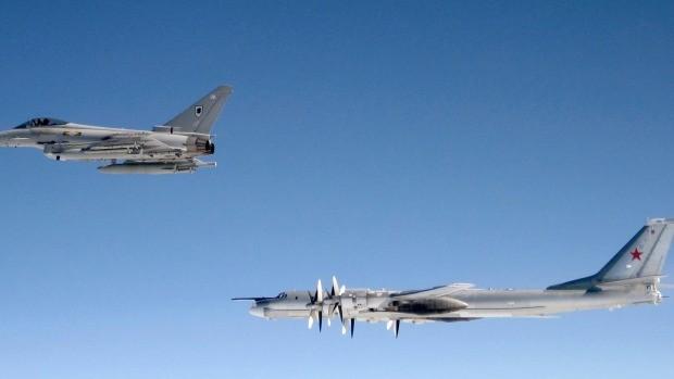 A British RAF Typhoon shadows a Russian Bear-H bomber