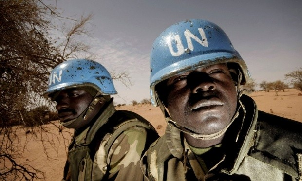 UNAMID peacekeepers patrol on the outskirts of a town in West Darfur