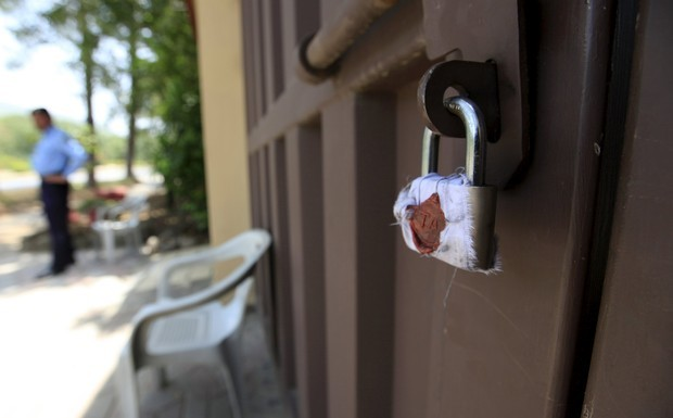 A sealed lock is seen at the gate of Save the Children charity's office in Islamabad