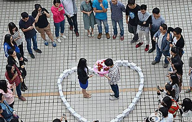 A Chinese man proposed his girlfriend by stacking 99 iPhone 6 in the form of a heart ahead of Singles Day. She turned him down, he is still single.