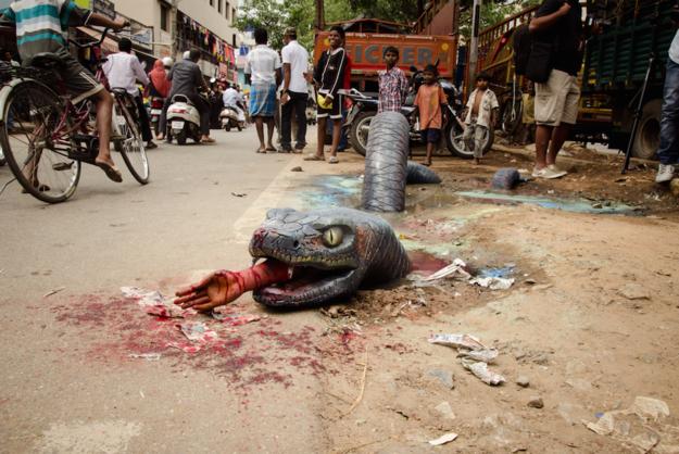 Anaconda on Bengaluru Potholes,Anaconda on Bengaluru streets,Anaconda,Bengaluru Potholes,Potholes,Anaconda paint,Bangalore artist creates Anaconda