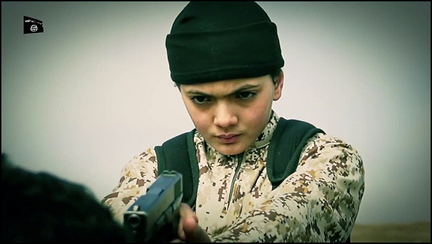 An Isis videograb showing a Belgian boy, 13, killing a man claimed to be an Israeli spy