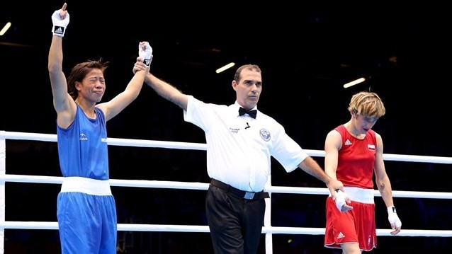 Mary Kom of India celebrates her victory Karolina Michalczuk of Poland during the Women's Fly (48-51kg) Boxing on Day 9.