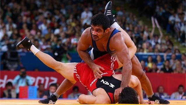 Sushil Kumar of India in action against Akzhurek Tanatarov of Kazakhstan