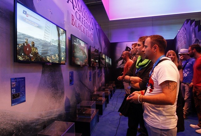 Visitors play Assassins Creed IV Black Flag with Playstation 4 during the Gamescom 2013