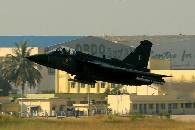 The Light Combat Aircraft, Tejas, takes to sky in Bengaluru on Friday, 20 December 2013. LCA Tejas received Initial Operational Clearance for Induction into Indian Air Force.