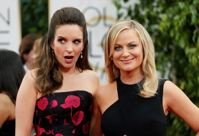 Golden Globe 2014 hosts Tina Fey and Amy Poehler pose on the red carpet