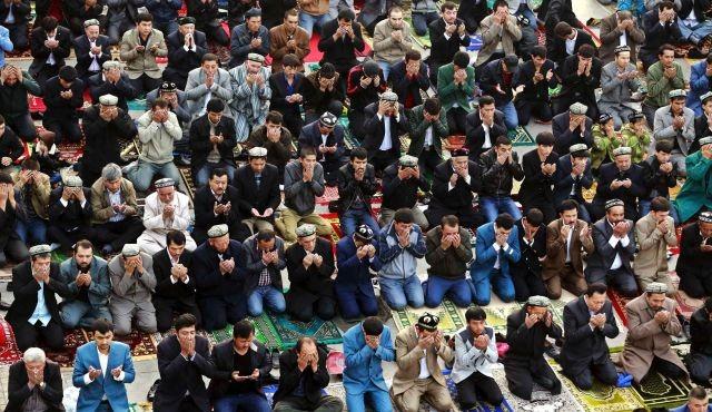 Muslims pray at a mosque in Xinjiang region