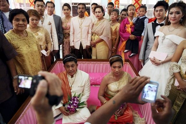 Bride and Groom Exchange Wedding Vows in Coffins in Bangkok
