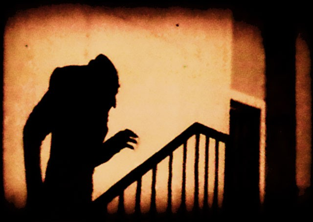 An iconic scene of the shadow of Count Orlok climbing up a staircase