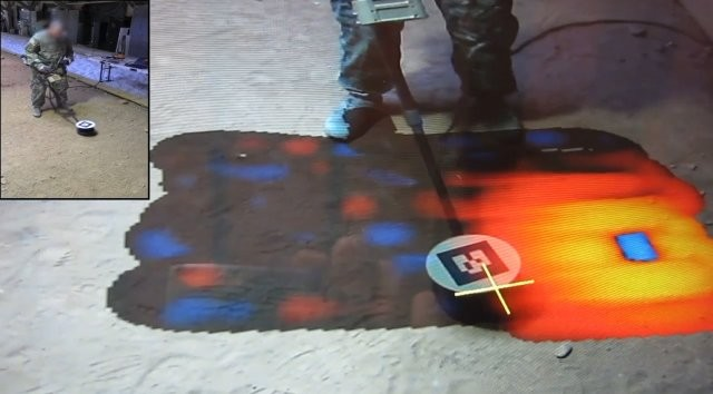 A video still image of real-time spatial location tracking, a piece of technology the Army is developing to visually alert a Soldier to hidden explosives in the ground rather than just a sound while sweeping with a mine detector.