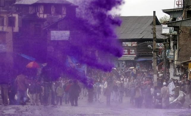 Protesting Kashmiri government employees are sprayed with dyed water by Indian police to disperse a demonstration in Srinagar April 10, 2012.
