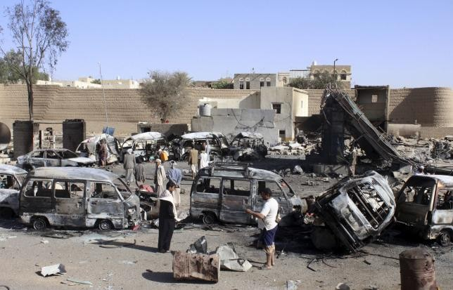 Burnt-out vehicles are seen at a gas station after it was hit by an air strike in Yemen's northwestern city of Saada, April 16, 2015.