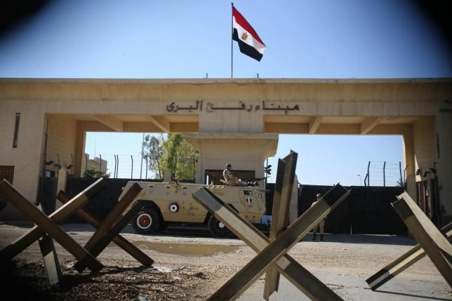An Egyptian soldier keeps watch at the closed Rafah border crossing, between southern Gaza Strip
