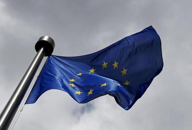 An European Union flag flutters outside the European Commission headquarters in Brussels, Belgium, June