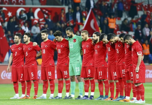 Turkey's players observe a minute of silence for the victims of Paris and Ankara attacks at Basaksehir Fatih Terim stadium before their international friendly soccer match against Greece in Istanbul, Turkey November 17, 2015.