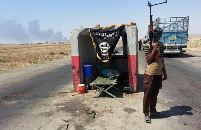 Isis guard at a checkpoint