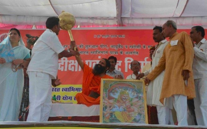 Baba Ramdev blessing one of his followers