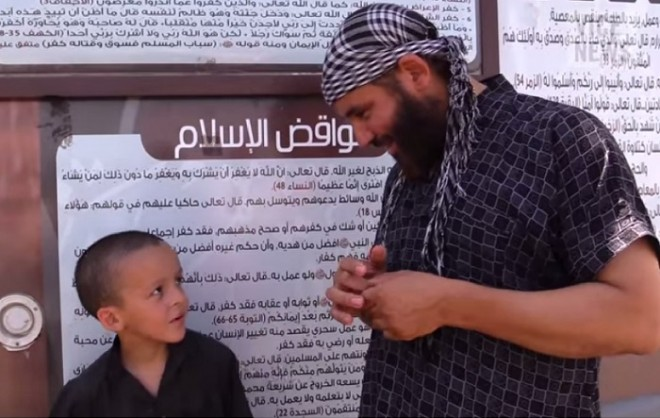 A Belgian ISIS militant with his son in Syria