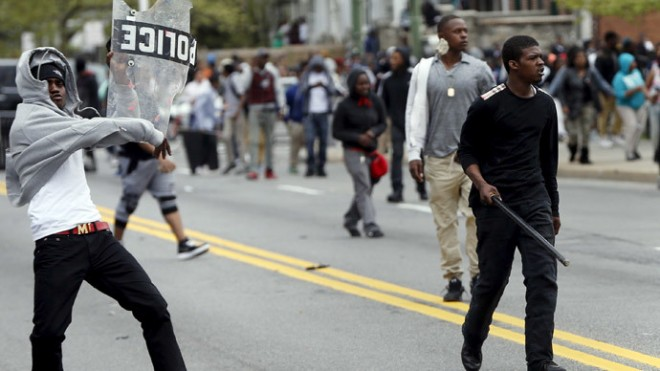 Demonstrators throw rocks at Baltimore police during clashes in Baltimore, Maryland April 27, 2015.