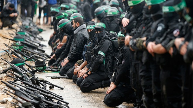 Palestinian members of al-Qassam Brigades, the armed wing of the Hamas movement