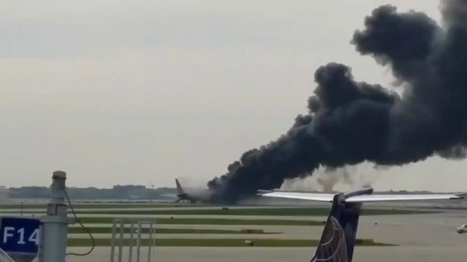American Airlines plane on fire at Chicago airport
