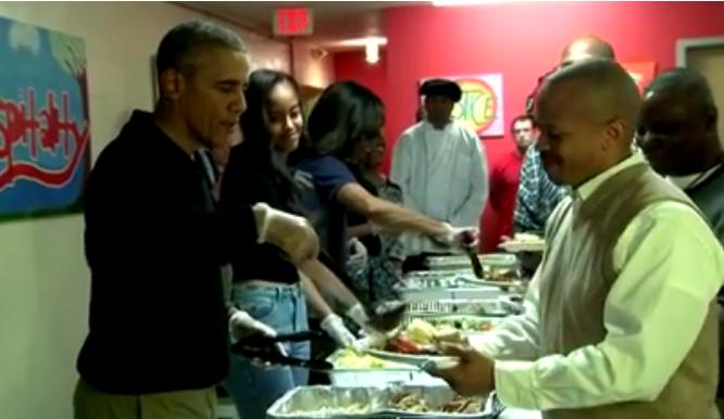 Barack Obama serves Thanksgiving dinner