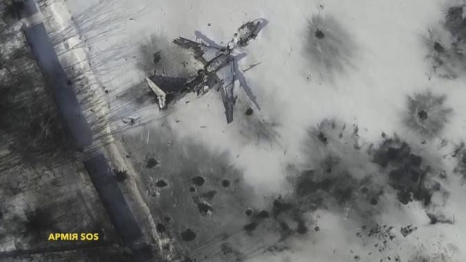 An aerial footage shot by a drone shows an outline of an airplane in the snow at the Sergey Prokofiev International Airport damaged by shelling during fighting between pro-Russian separatists and Ukrainian government forces, in Donetsk, eastern Ukraine