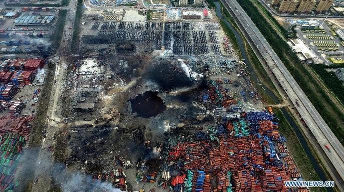 Tianjin Blast,Tianjin blasts,tianjin crater,crater at tianjin blast site,huge crater,tianjin,china blast,tianjin explosion pictures,china chemical factory blast