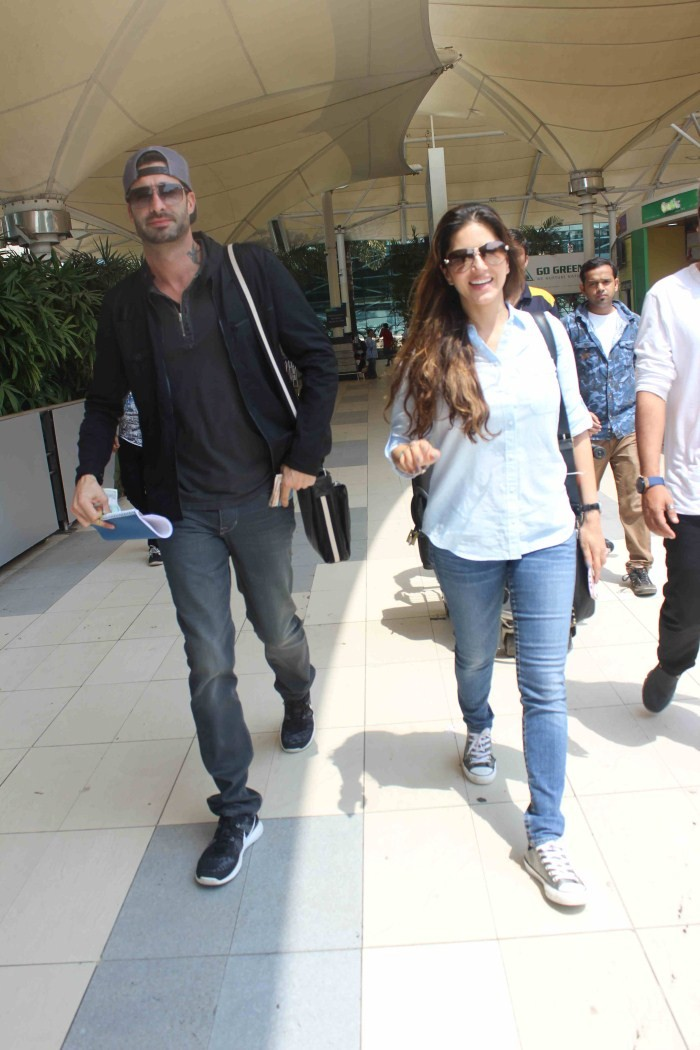 Sunny Leone spotted at Airport,Sunny Leone,actress Sunny Leone,Sunny Leone pics,Sunny Leone images,Sunny Leone photos,hot Sunny Leone,Sunny Leone hot pics,Sunny Leone latest pics,Daniel Weber,Daniel Weber and sunny leone