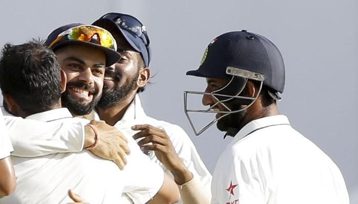 India beat West Indies,India vs West Indies,India defeated West Indies,Sir Vivian Richards Cricket Stadium,Ravichandran Ashwin,Virat Kohli,Kohli,India beat West Indies by innings and 92 runs