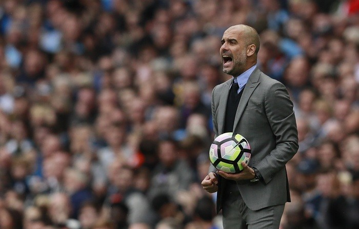Manchester City boss Guardiola wants one last push for Champions League spot