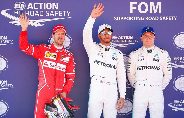 Lewis Hamilton overtakes Sebastian Vettel for the lead of the Spanish GP