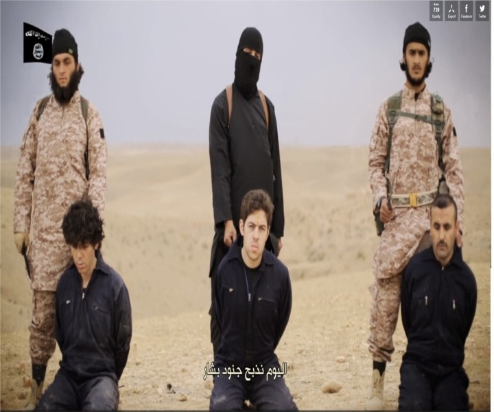 Photo: The Peter Kassig beheading video shows Jihadi john leading Americna aid worker's killing along with a gruesome mass execution of 16 other Syrian soldiers.