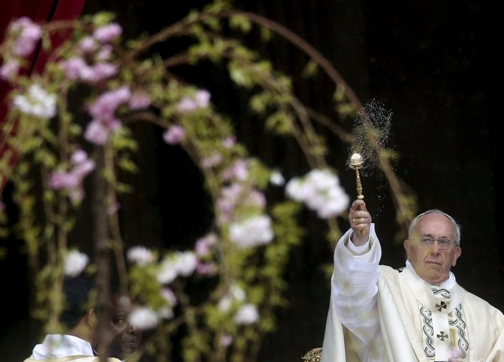 Pope Francis blesses the altar during the Easter mass in St. Peter's square at the Vatican