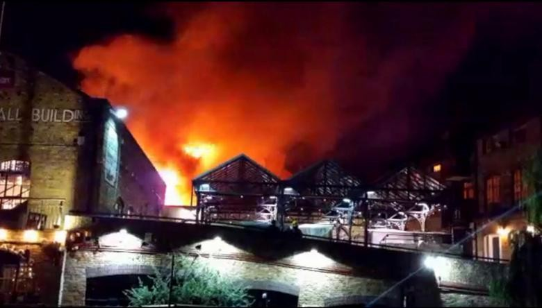 Firefighters battle large blaze at London's Camden Lock Market