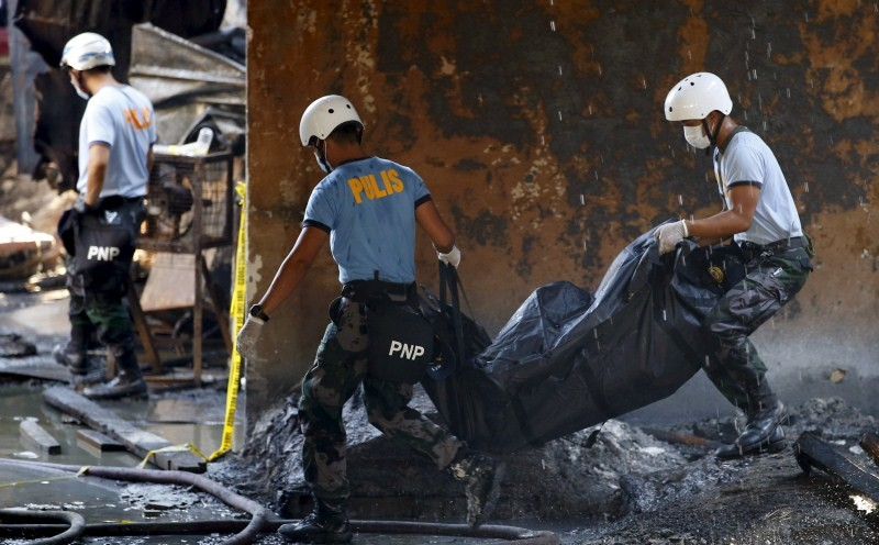 Factory Fire in the Manila,Factory Fire,fire accident,major fire accident,Philippine factory fire,factory fire,Philippine capital of Manila,footwear factory,fire accident pics,fire accident images,fire accident photos,fire accident stills