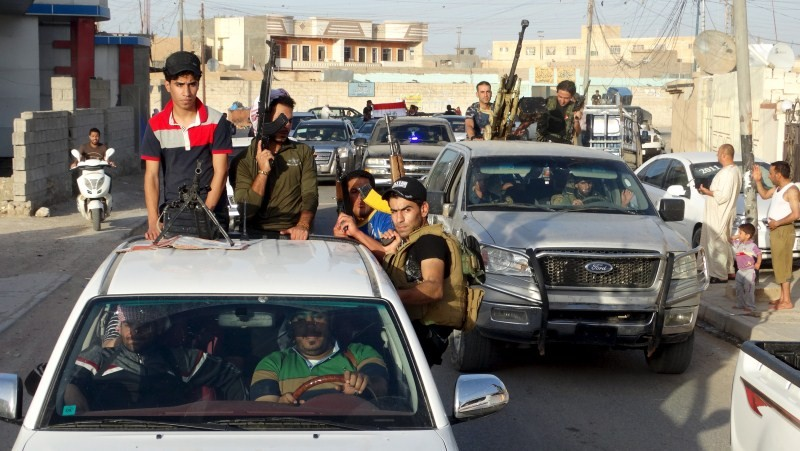 ISIS Raises Flag Over Ramadi,ISIS attacking,security forces,Mosque,provincial government building,ISIS Seizes Most of Iraq's Ramadi,ISIS captures capital of Iraqi Anbar,Isis drives Iraqi troops out,Islamic State (ISIS) terrorists,Islamic State terrorists