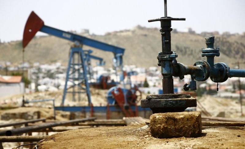 Oil pump,Oil pump Baku,Oil pump in Baku,Oil pump is pictured on a Sunny Day,Sunny Day,Baku,Baku oil pump,Azerbaijan