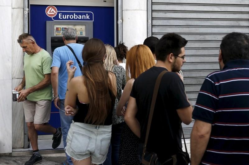 Greece Crisis Deepens,World stock markets,World stock,Greece in shock,Greece,World Stock Markets,Greece banks,Greece in shock as banks shut after snap referendum call,Eurobank branch,Eurobank